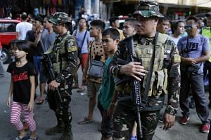 Filipino soldiers standing guard on a street in Manila on Aug 1, 2018.