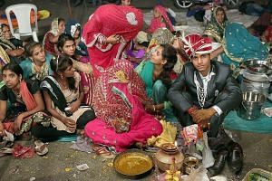 A marriage ceremony in 2016 in the Pal community of northern India. Child marriage in India, according to Indian law, is a marriage where either the woman is below age 18 or the man is below age 21.