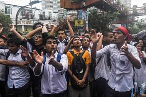 Bangladeshi students blocking a road during a student protest in Dhaka following the deaths of two college students in a road accident on July 30, 2018.