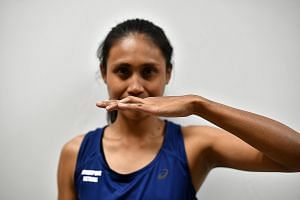 BENT FINGER: Nurul Baizura's ring finger remains bent after she caught a netball awkwardly in 2014. She even had to put her wedding ring on her right hand.