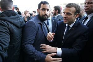 French President Emmanuel Macron (left) is seen with his personal bodyguard Alexandre Benalla in a photo taken in February this year. The scandal over Benalla allegedly punching protesters who stood in Mr Macron's way has shed an unflattering light o