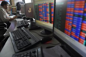 A stock trader watches share prices on his screen at a brokerage house in Mumbai, India, on July 26, 2018.