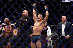 Henry Cejudo celebrates his UFC Flyweight Title Bout win over Demetrious Johnson during UFC 227 at Staples Center in Los Angeles on Aug 4, 2018.