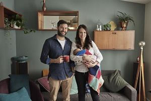 New Zealand Prime Minister Jacinda Ardern, holding her newborn baby Neve, poses with her partner Clarke Gayford for a family photo in New Zealand, on Aug 1, 2018.