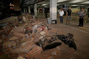 Motorcycles crushed by debris at a shopping centre in Kuta on Bali island yesterday after the quake struck. Tremors could be felt in nearby Bali when the quake struck Lombok island.