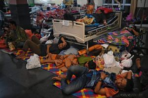 Patients sleep at the lobby of a provincial hospital in Mataram on Indonesia's Lombok island, so it would be easier to evacuate in case of another tremor.