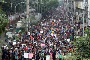 Thousands of students join in a protest in Dhaka on Aug 5, 2018, over recent traffic accidents that killed a boy and a girl.
