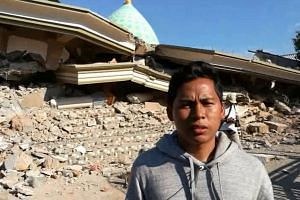 Lalu Fauzan said his mother remains trapped under the rubble of the Jami'ul Jama'ah mosque following Sunday's earthquake in Lombok, Indonesia.