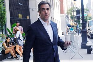 Cohen exits his hotel in Manhattan, New York, in July 2018.
