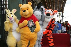 Winnie The Pooh (front) receiving a star on the Hollywood Walk of Fame in a 2006 file photo.