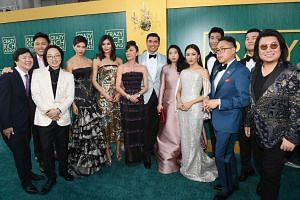 The cast of Crazy Rich Asians (from left) Ken Jeong, Jon M. Chu, Jimmy O. Yang, Sonoya Mizuno, Gemma Chan, Michelle Yeoh, Henry Golding, Awkwafina, Constance Wu, Chris Pang, Nico Santos, Ronny Chieng, and author Kevin Kwan at the Crazy Rich Asians pr