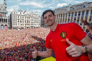 Courtois celebrating winning bronze at the 2018 World Cup in Brussels.