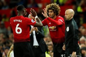 United's Marouane Fellaini comes on as a substitute to replace Paul Pogba.