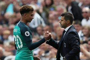 Tottenham manager Mauricio Pochettino shakes hands with Dele Alli.