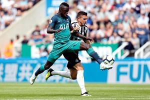 Newcastle United's Joselu in action with Tottenham's Davinson on Aug 11, 2018.