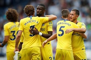 Chelsea's Marcos Alonso, Antonio Rudiger, Jorginho and Eden Hazard celebrate after the match.