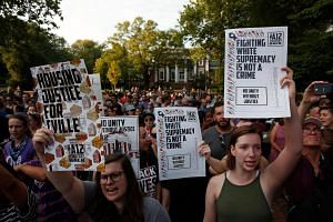 Protesters gather at an event on the campus of the University of Virginia marking the one year anniversary of a deadly clash between white supremacists and counter protesters, on Aug 11, 2018 in Charlottesville, Virginia.