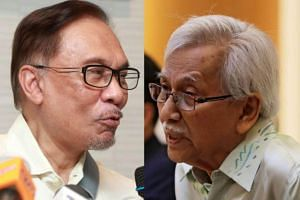 Tun Daim Zainuddin (right) was accused by Kapar MP Abdullah Sani of being among individuals behind a conspiracy to prevent Datuk Seri Anwar Ibrahim (left) from becoming Prime Minister.