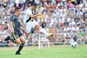 Juventus' Cristiano Ronaldo (right) at a soccer friendly match between Juvents A and Juventus B at Villar Perosa, Turin, on Aug 12, 2018.