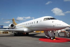 A Bombardier Global 5000 aircraft at Singapore Airshow 2010. Malaysian Prime Minister Mahathir Mohamad said that businessman Low Taek Jho's Bombardier Global 5000 jet would be returned to Malaysia