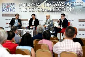 (From left) Straits Times foreign editor and panel moderator Zakir Hussain; OCBC Bank's head of treasury research and strategy Selena Ling; Professor Joseph Liow, dean of NTU's College of Humanities, Arts and Social Sciences and S. Rajaratnam School