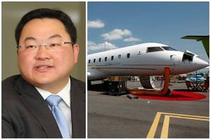 A file photo of a Bombardier Global 5000 aircraft (right), seen at the Singapore Airshow 2010. Singapore authorities have confirmed that a similar aircraft, believed to be owned by fugitive businessman Low Taek Jho, is currently parked at Seletar A