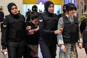 Vietnamese defendant Doan Thi Huong (right) and Indonesian defendant Siti Aishah (second from left) are escorted by Malaysian police personnel at the low-cost carrier Kuala Lumpur International Airport 2 in Sepang, on Oct 24, 2017.