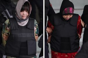 Vietnamese Doan Thi Huong (left) and Indonesian Siti Asiyah are escorted out of the Shah Alam High Court in Shah Alam, Malaysia, on Aug 16, 2018.