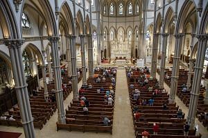Parishioners celebrating the Feast of the Assumption at St Paul's Cathedral in Pittsburgh on Wednesday. A grand jury report on Tuesday described the abuse of more than 1,000 young people by hundreds of priests in Pennsylvania. Pittsburgh was the site