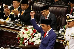 All eyes on President Joko as he gave his annual speech, calling on his countrymen to step up the pace of development. President Joko Widodo delivering a speech in Parliament yesterday, the eve of Indonesia's Independence Day. He outlined several sig