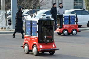 Driverless delivery vehicles for  JD.com during a test operation at the Sino-Singapore Tianjin Eco-City in Tianjin on Jan 18, 2018.