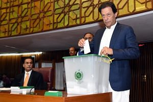 Imran Khan of the Pakistan Tehrik-e-Insaf party casting his vote for the election of the Speaker of the House, in Islamabad, Pakistan, on Aug 15,  2018.