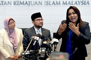 (From left) Deputy Minister in the Prime Minister's Department Fuziah Salleh; Datuk Dr Mujahid Yusof Rawa, Minister in the Prime Minister's Department (Religion); and transgender Nisha Ayub at Jakim on Aug 10.