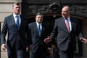 The defense attorneys for former Trump campaign manager Paul Manafort, including lead attorney (from left) Kevin Downing, Richard Westling and Thomas Zehnle, leave the Albert V. Bryan US Courthouse in Alexandria, Virginia, on Aug 17, 2018.