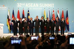 Leaders of the Asean countries doing the Asean Wave at the 32nd Asean Summit.