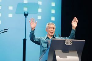 Prime Minister Lee Hsien Loong greeting the crowd before giving his National Day Rally speech at ITE College Central on Aug 19, 2018.