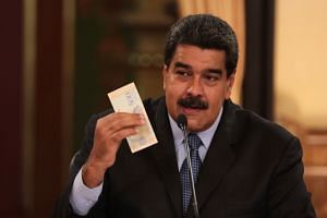 In Venezuelan President Nicolas Maduro's great currency devaluation, a 95-per-cent plunge tested the capacity of an already beleaguered population, which stomached even more pain.