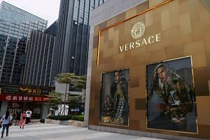 File photo showing shopping windows of Italian luxury brand Versace in Fujian province, China. Global luxury brands are investing in China to focus on smaller cities even as the world's second-largest economy slows.