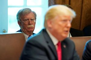 White House national Security Advisor John Bolton listens as US President Donald Trump holds a cabinet meeting at the White House in Washington, US, on Aug 16, 2018.