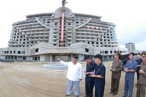 An undated photo showing North Korean leader Kim Jong Un (left) inspecting the construction site of the Wonsan-Kalma coastal tourist area in Kangwon Province.