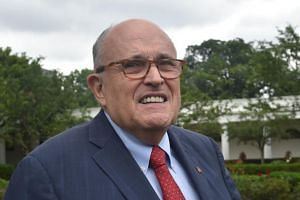 US President Donald Trump's lawyer, Rudy Giuliani, walks outside the White House in Washington, DC, on May 30, 2018.