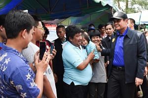 Thai Prime Minister Prayut Chan-o-cha (right) greeted local villagers during his up-country trips for mobile cabinet meetings in Chumphon province, southern Thailand, on Aug 21, 2018.