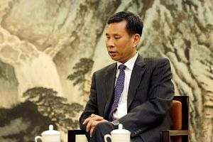Chinese Finance Minister Liu Kun speaks during an interview with Reuters at the Ministry of Finance in Beijing, China, on Aug 23, 2018.