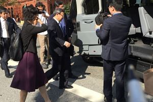 A Chinese delegation led by Vice-Minister of Commerce Wang Shouwen (centre) leaves US Treasury after talks.