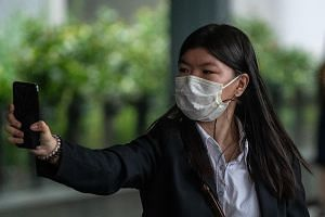Ms Khaw May Ling, the eldest daughter of Khaw Kim Sun, who is accused of murdering his wife and his younger daughter, leaving the High Court yesterday. She told the court she was aware of her father's affair with her tutor.