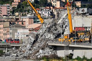 Cranes at work to remove the rubble of the Morandi highway bridge, in Genoa, Italy, on Aug 26, 2018.