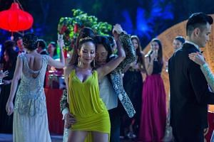 Fiona Xie as Kitty Pong, dancing with Bernard Tai (Jimmy O. Yang) in Crazy Rich Asians.