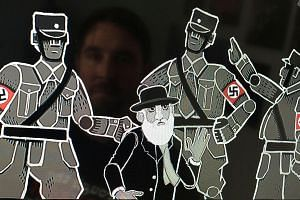 Mr Joerg Friedrich (above), founder and game designer at Paint Bucket Games, will launch his historical resistance strategy game Through The Darkest Of Times next year. The game features the swastika (right).