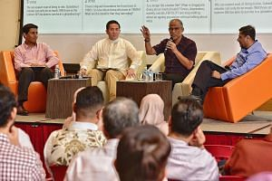 (From left) Dr Mathew Mathews of the Institute of Policy Studies, Senior Parliamentary Secretary Amrin Amin, Minister-in-charge of Muslim Affairs Masagos Zulkifli and Dr Mustafa Izzuddin of ISEAS - Yusof Ishak Institute at a panel discussion at Menda