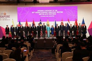 Prime Minister Lee Hsien Loong and Trade and Industry Minister Chan Chun Sing pose for a photo with representatives from the Asean member states at the 50th Asean Economic Ministers' Meeting, on Aug 29, 2018.